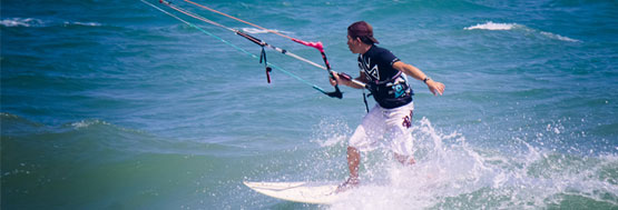 Kiteboarder wave riding