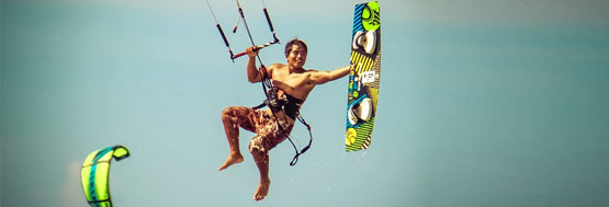 kiteboard instructor doing a trick in the air